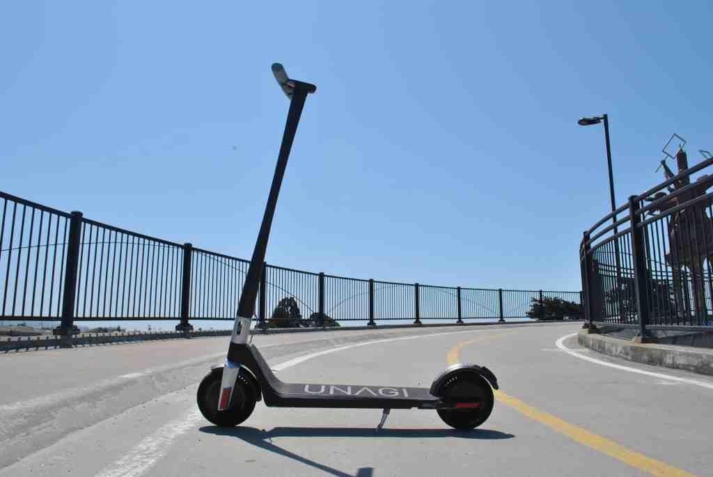 Unagi Model One electric scooter unfolded on bridge