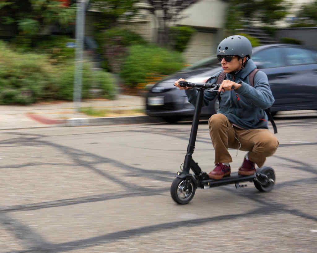 Man riding Fluid FreeRide Horizon electric scooter
